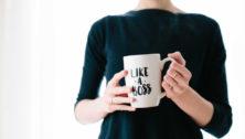 Woman holding coffee mug.