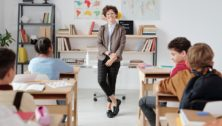 Teacher Pauses in front of a classroom