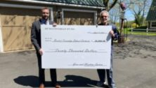 Gene Epstein (right) presents check to Josh Sweigard (left), Business Manager at BTSD