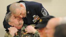 Jesse Hill, embraced by fellow veteran David Pearl in 2015.