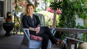 woman on porch with flowers Sears 'Kit' Home
