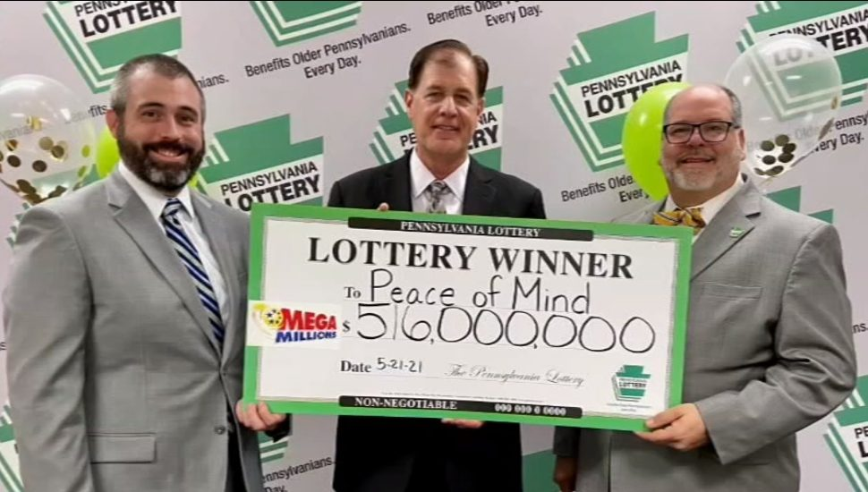 Attorneys for the Peace of Mind Trust pose with the Mega Millions check disbursement