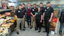 Signing bonuses are an incentive to bring new workers to Wawa's stores, like those pictured in this Wawa worker group shot.