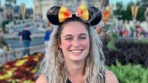 girl with mickey ears at disney