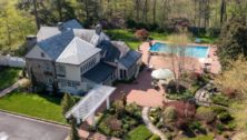 drone shot of house and pool