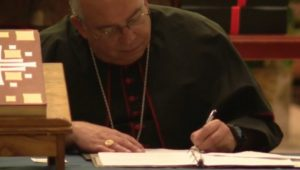 Archbishop Nelson Perez signed a cause of beatification package.