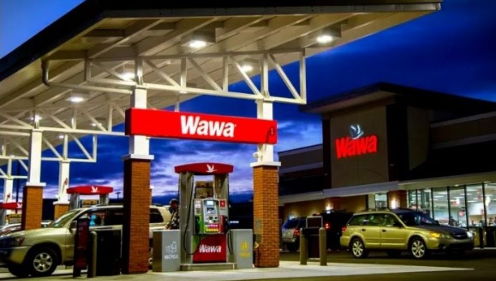 The outside of a Wawa store and gas pumps.