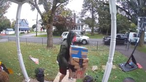 man on porch with packages