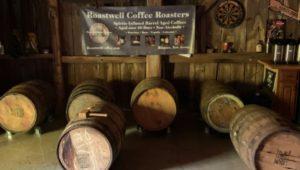 wooden barrels in a barn